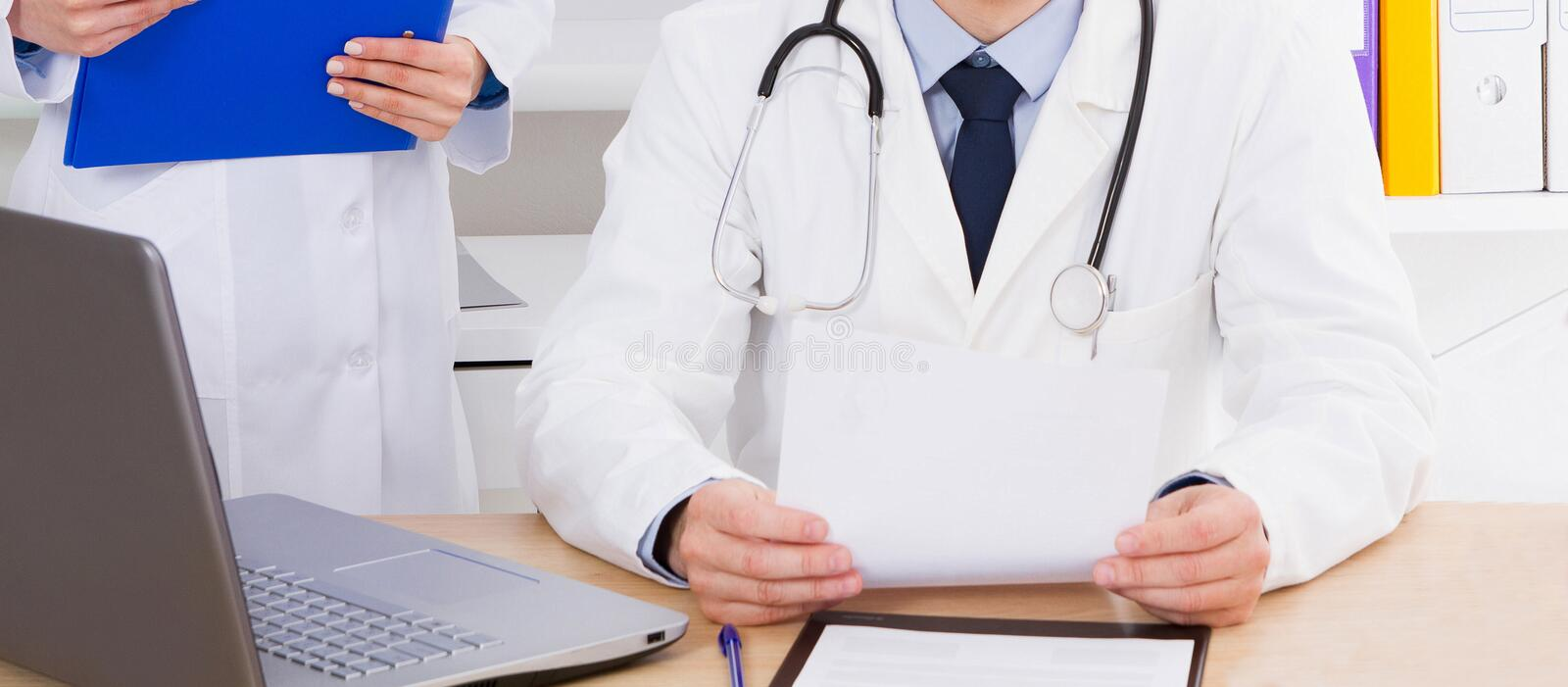 Portrait of senior doctor in medical office stock photography