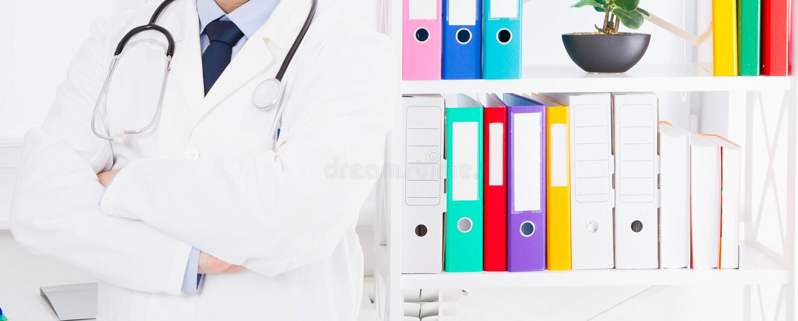 Portrait of senior doctor in medical office stock image