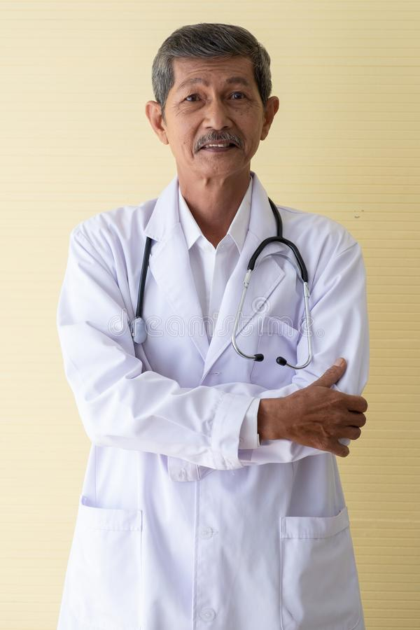 Portrait of a senior doctor smiling stock photo