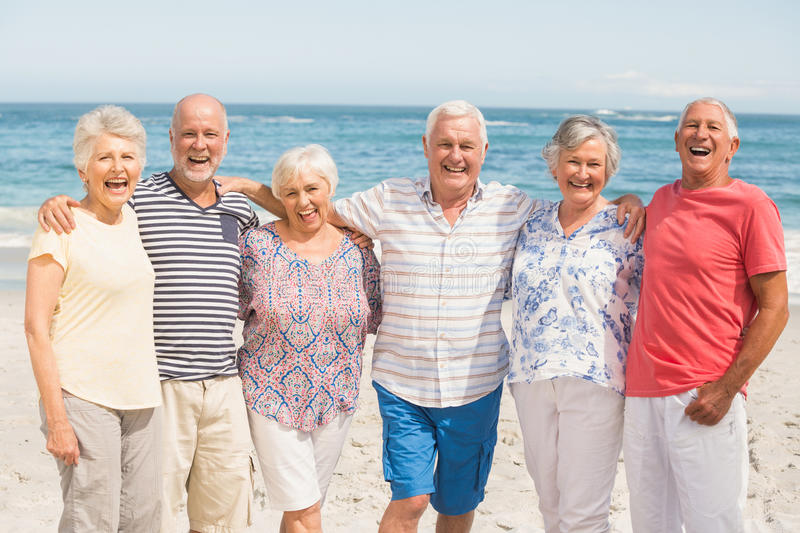 Portrait of senior friends at the beach stock photo