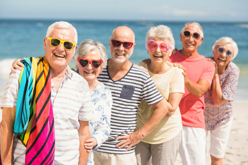 Portrait of senior friends at the beach royalty free stock photos