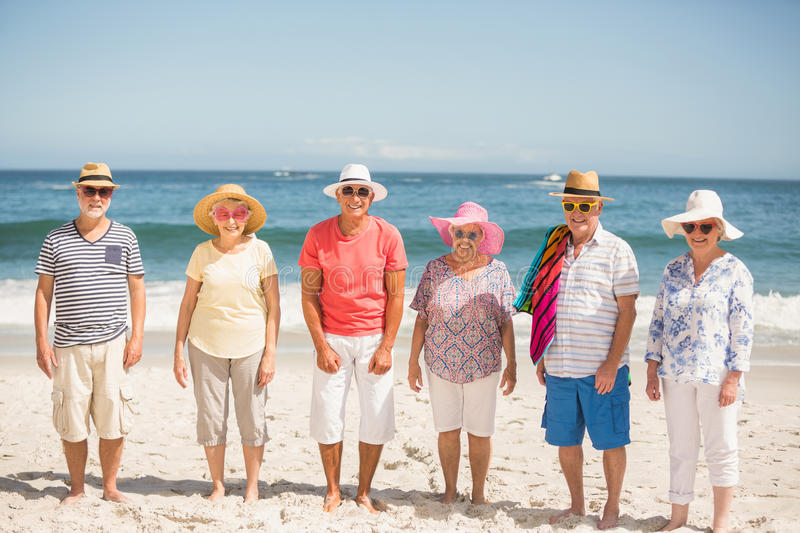 Portrait of senior friends at the beach royalty free stock images