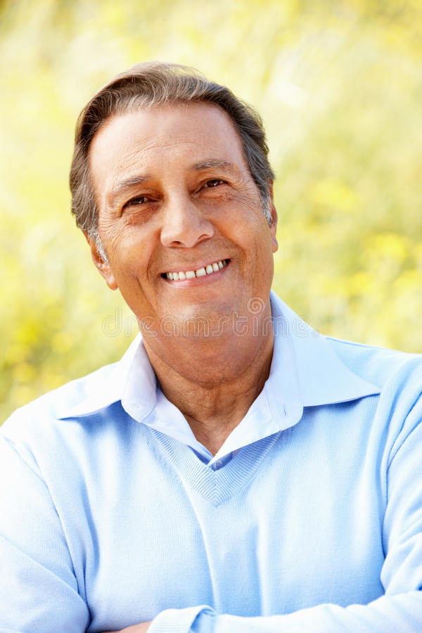 Portrait senior Hispanic man outdoors royalty free stock image