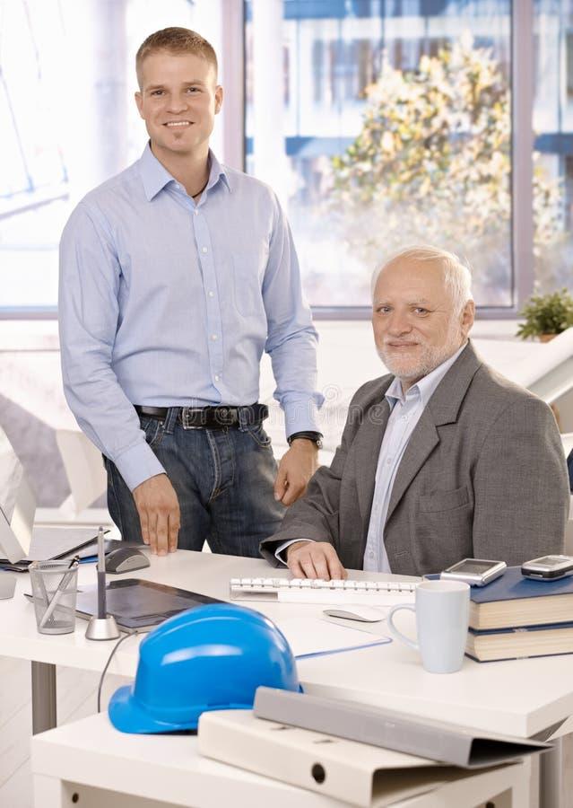 Portrait of senior and junior businessmen royalty free stock photos