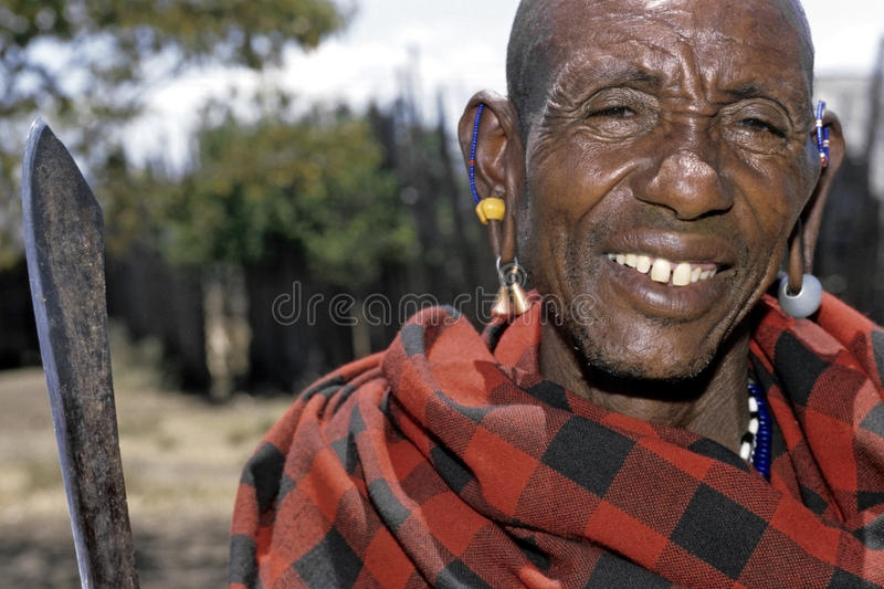 Portrait senior Maasai man with stretched earlobes. Kenya: closeup of elderly man, a member of the Kenyan nature people, the tribe, the Masai, who live in the royalty free stock photography