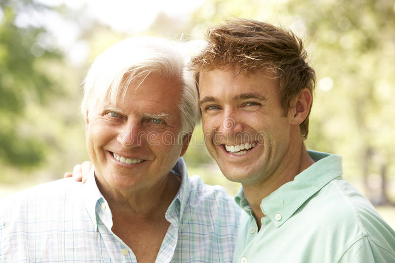 Portrait Of Senior Man With Adult Son stock photos