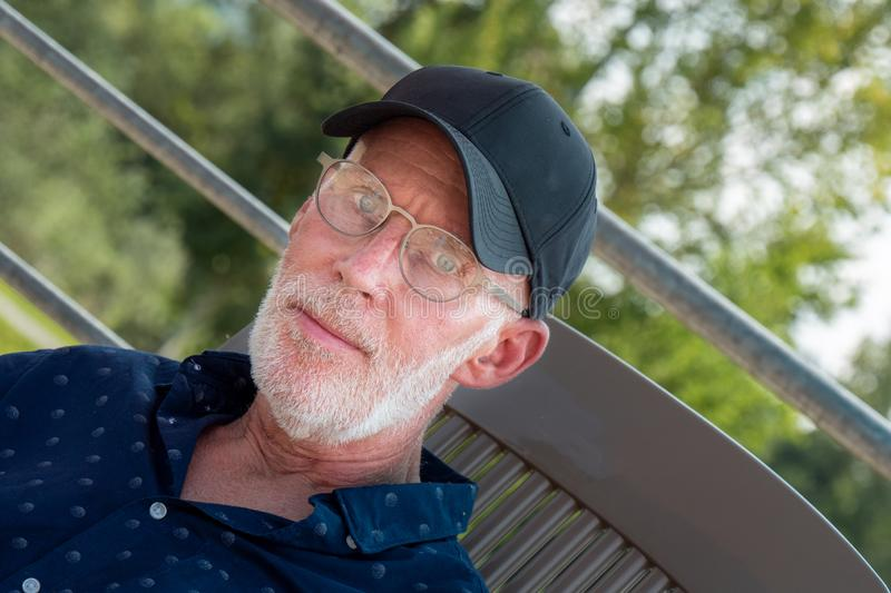 Portrait of senior man with beard and glasses royalty free stock image