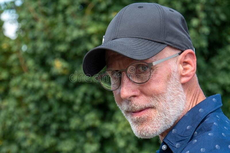 Portrait of senior man with beard and glasses stock photography
