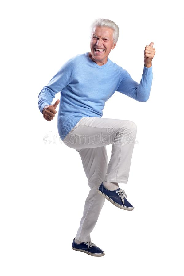 Portrait of senior man dancing on white background royalty free stock images