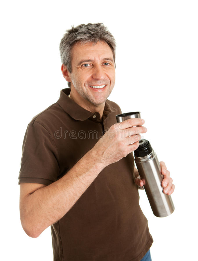 Portrait of senior man drinking coffee/tea royalty free stock image