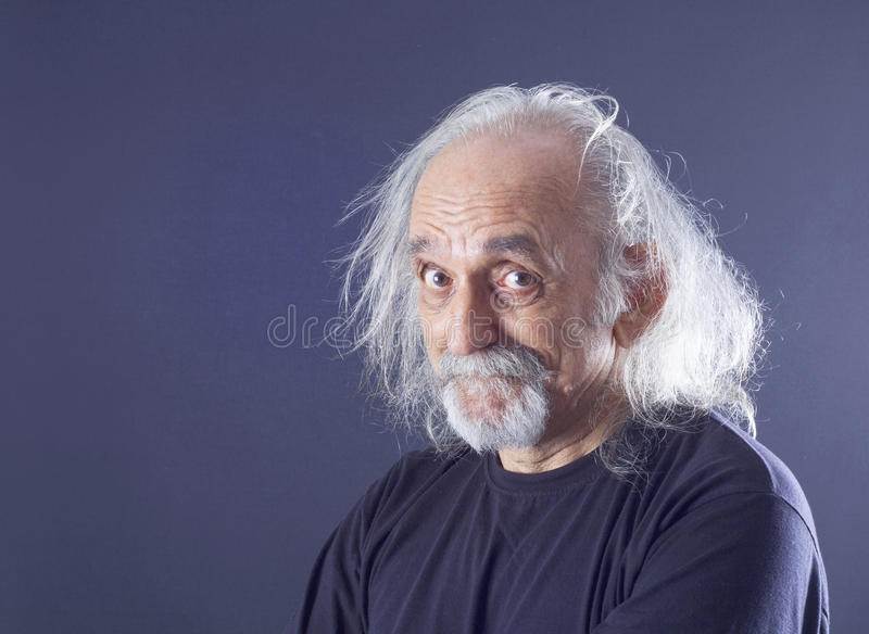 Portrait of a senior man. On gray royalty free stock photo