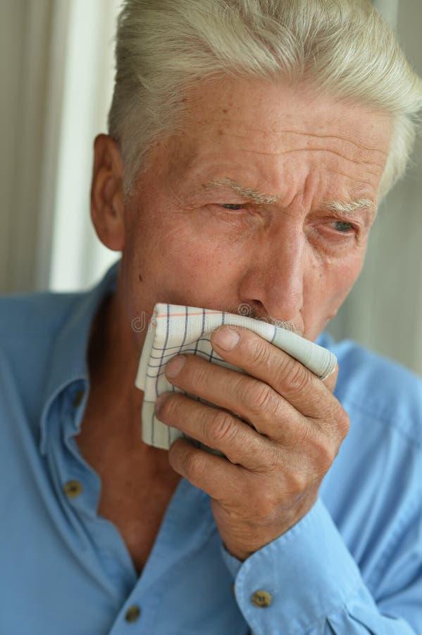 Senior man coughing stock images