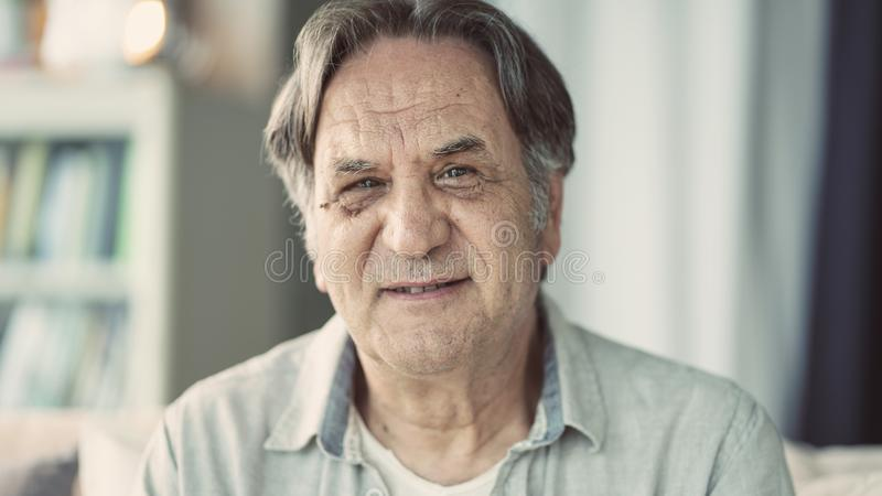 Portrait of senior man at home stock photos
