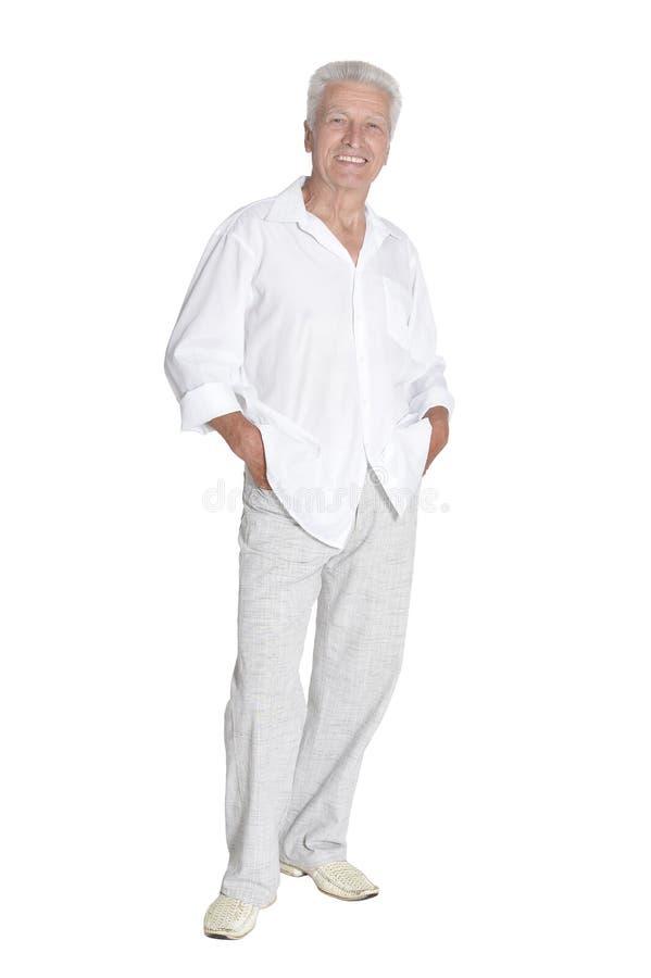 Portrait of senior man posing on white background royalty free stock images