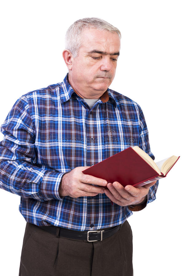 Portrait of senior man standing and reading a book royalty free stock photography