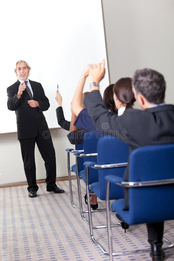 Portrait of a senior manager giving presentation stock photography