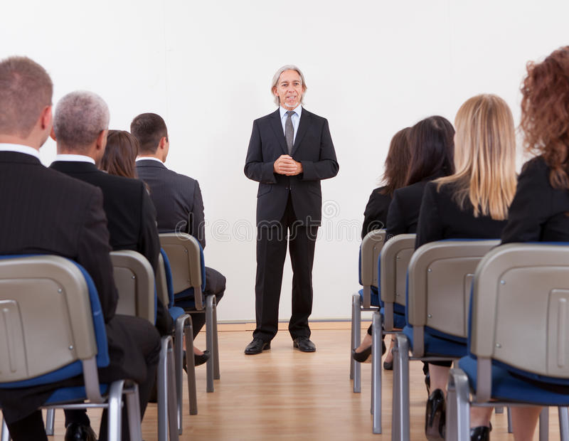 Portrait Of A Senior Manager Giving Presentation royalty free stock photos