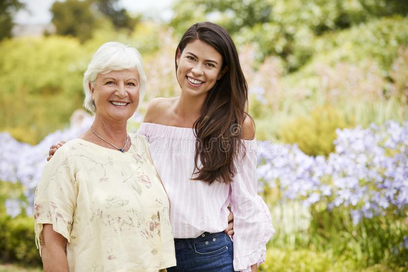 Portrait Of Senior Mother With Adult Daughter On Walk In Park royalty free stock photo