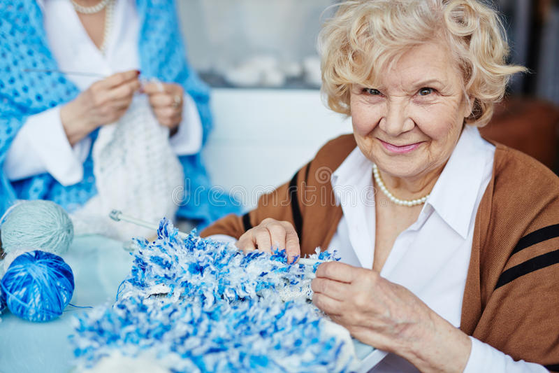 Portrait of senior needlewoman royalty free stock image