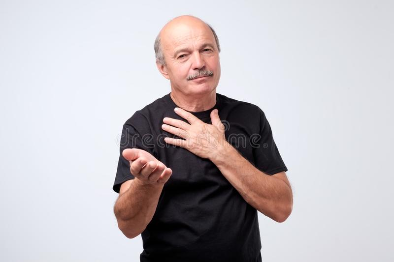 Portrait of a senior poor man asking for money stock image