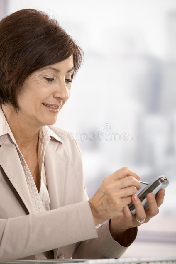 Download Portrait Of Senior Professional With Pda Stock Photo - Image: 17834440