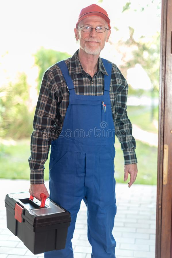 Portrait of a repairman holding his toolbox royalty free stock image