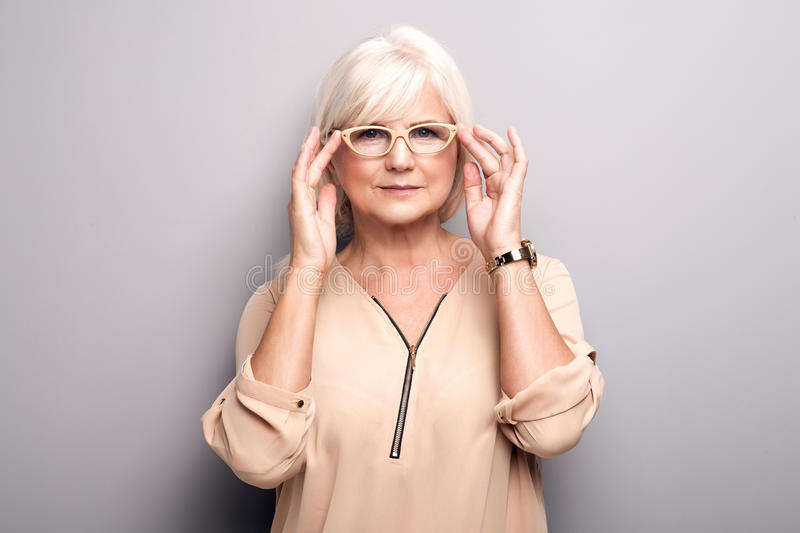 Portrait of senior woman in eyeglasses. royalty free stock image