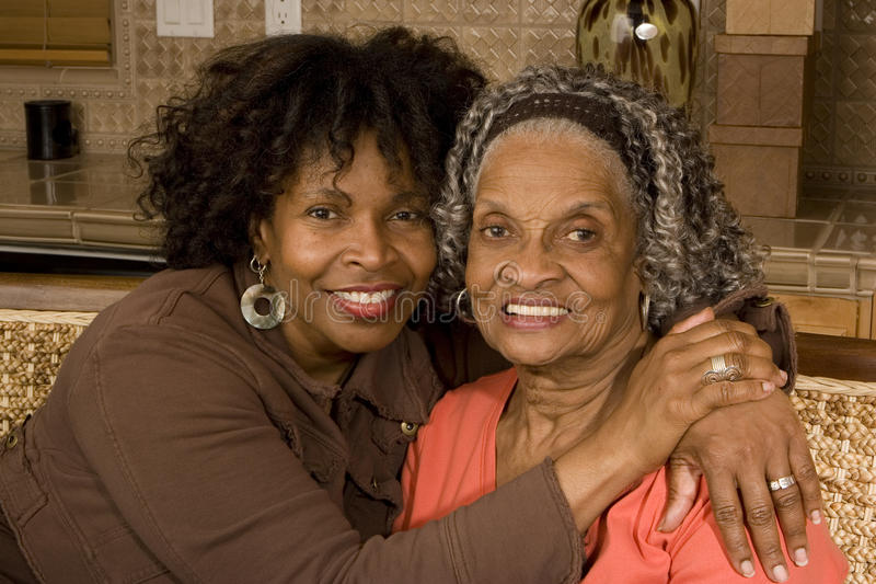 Portrait of a senior woman hugging her daughter. royalty free stock image