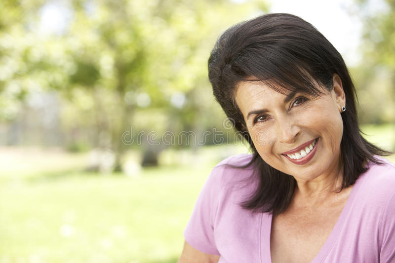 Download Portrait Of Senior Woman In Park Stock Photo - Image of horizontal, fifties: 11503012