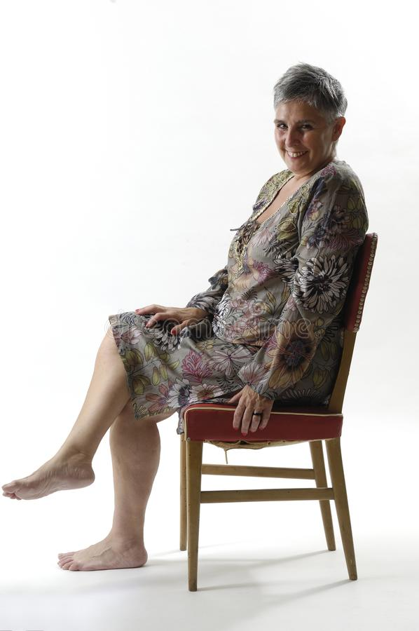 Portrait of a senior woman sitting with short stock photos