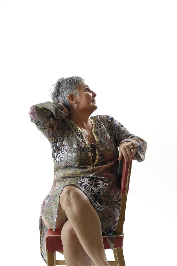 Portrait of a senior woman sitting with short hair stock photos