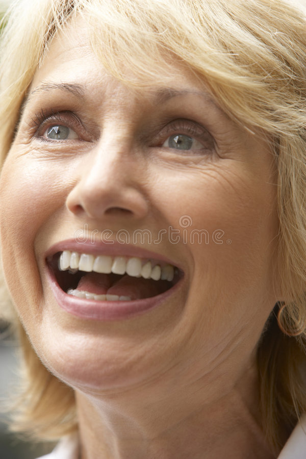 Portrait Of Senior Woman Smiling Happily royalty free stock photography