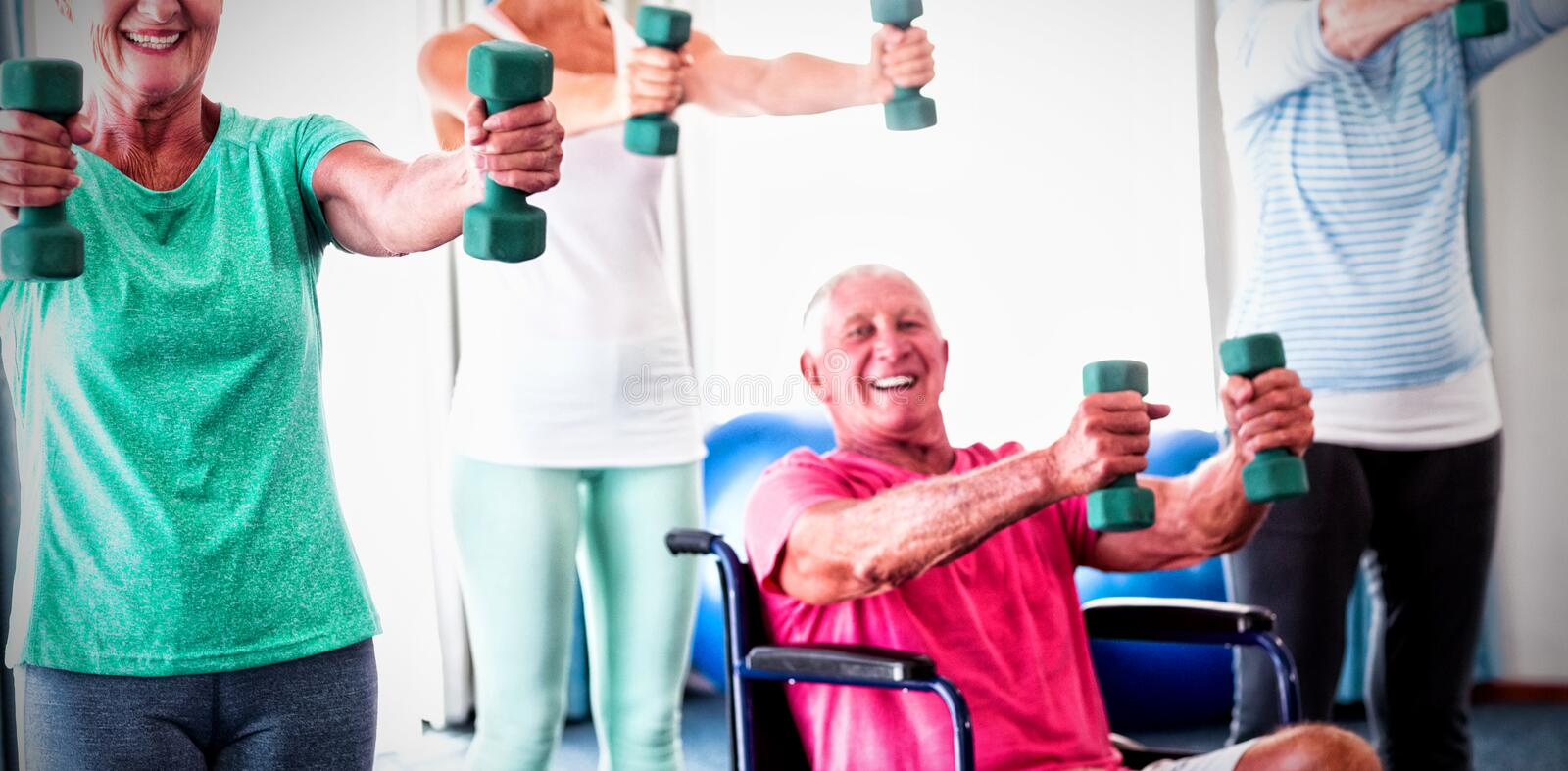 Portrait of seniors exercising with weights royalty free stock images