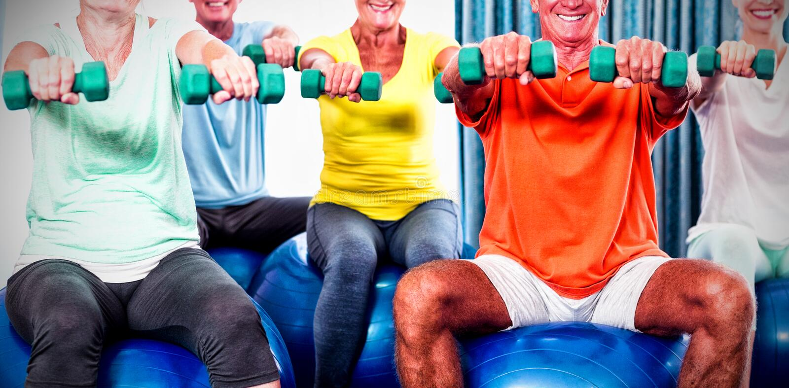 Portrait of seniors using exercise ball and weights royalty free stock photography