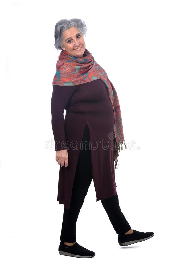 Portrait of a senir woman walking on white royalty free stock photo