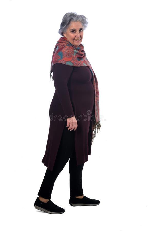 Portrait of a senir woman walking on white stock image