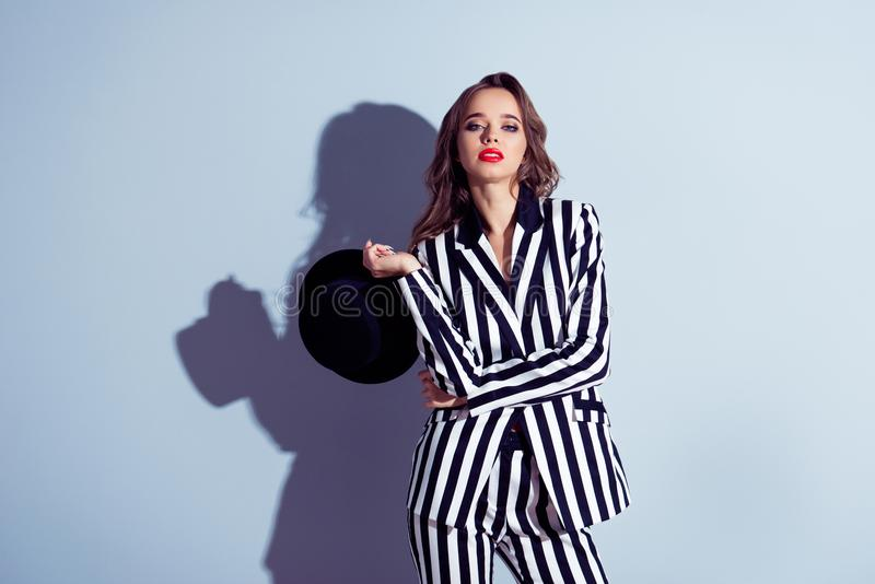 Portrait of sensitive charming attractive gorgeous self-assured. Confident emancipated classy luxury retro authoritative woman taking off holding hat with round stock photos