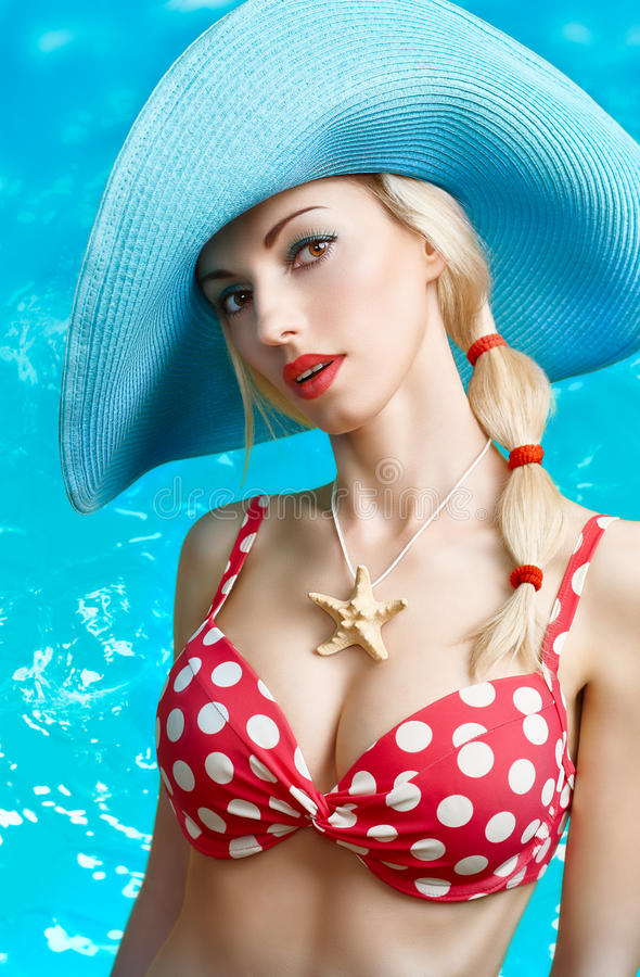 Beautiful woman in red polka dots fashionable swimsuit. PinUp royalty free stock images