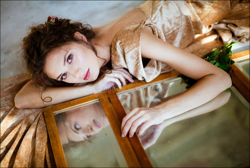 Portrait of a sensual kinky girl with closed eyes bare backed in stock images