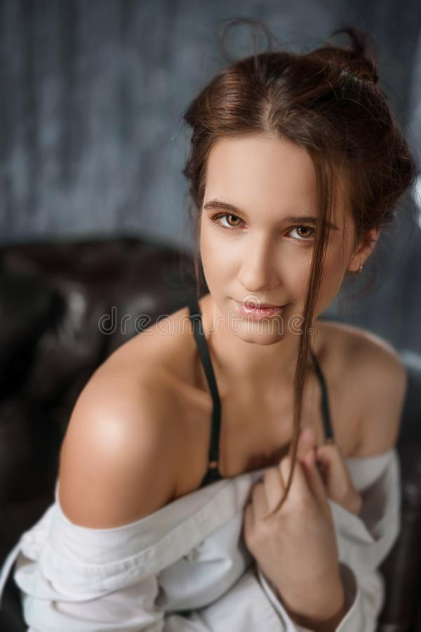 Portrait of sensual young beautiful woman in white shirt, seduction.  royalty free stock image