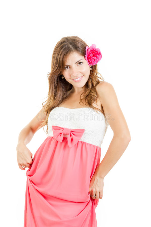 Portrait of sensual young woman with flower in her hair. Portrait of sensual young woman in dress with pink flower in her hair royalty free stock photo