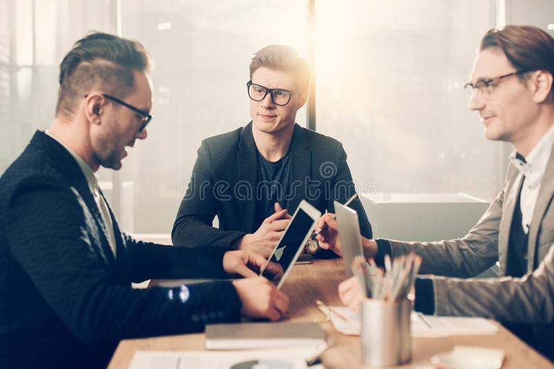 Serious comrades discussing at conference royalty free stock photo