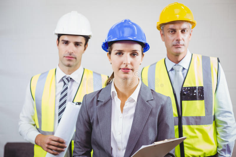 Portrait of serious architects with clipboard stock photo