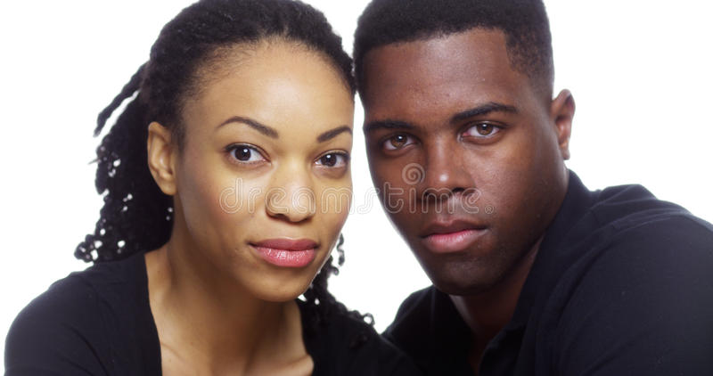 Portrait of serious black couple looking at camera royalty free stock image