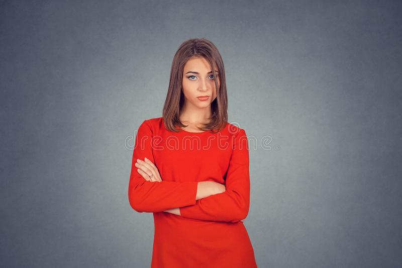 Confident woman standing with arms folded stock images