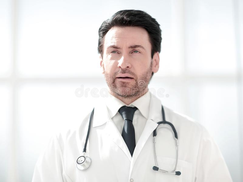 Portrait of serious doctor on blurred background royalty free stock photos