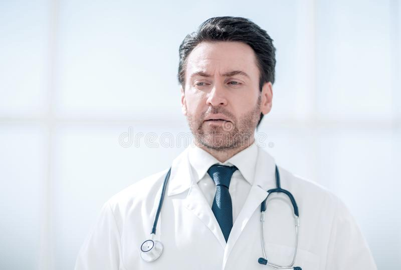 Portrait of serious doctor on blurred background royalty free stock images