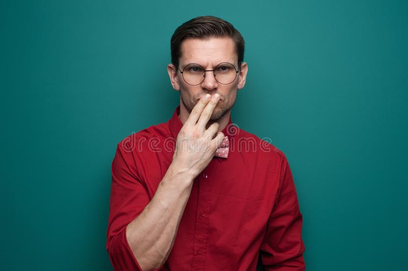 Portrait of a serious doubting man in glasses royalty free stock photography