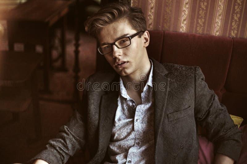 Portrait of the serious elegant boy stock image