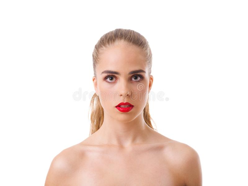 Portrait of a serious European girl, with bare shoulders. Isolated on white. royalty free stock photography